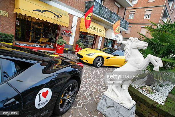Ferrari SpA automobiles stand parked outside a retail outlet selling Ferrari merchandise in Maranello Italy on Thursday Oct 15 2015 Fiat Chrysler...