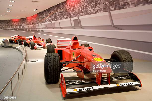 Ferrari SpA Formula One race cars sit on display in the Galleria Ferrari gallery at Ferrari World Abu Dhabi Ferrari's first theme park in Abu Dhabi...