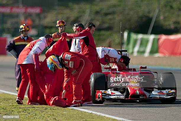 Ferrari Spanish driver Fernando Alonso stands trackside after a breakdown during a testing session at Jerez racetrack on January 30 2014 in Jerez AFP...
