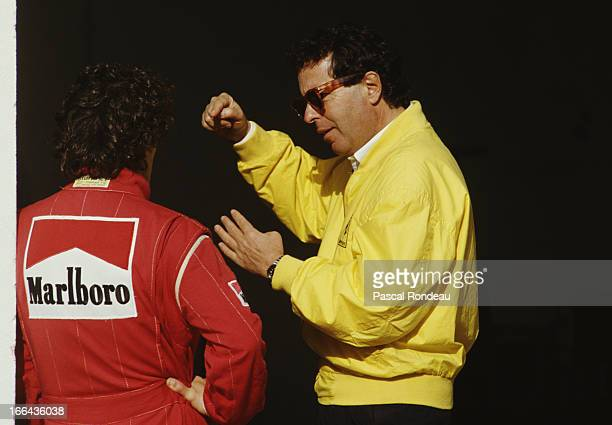 Ferrari Sporting Director Cesare Fiorio talks with Alain Prost of France driver of the Scuderia Ferrari SpA Ferrari 641 Ferrari 35 V12 during pre...