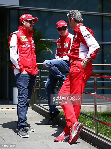 Ferrari Team Principal Maurizio Arrivabene chats with Kimi Raikkonen of Finland and Ferrari and Sebastian Vettel of Germany and Ferrari during final...