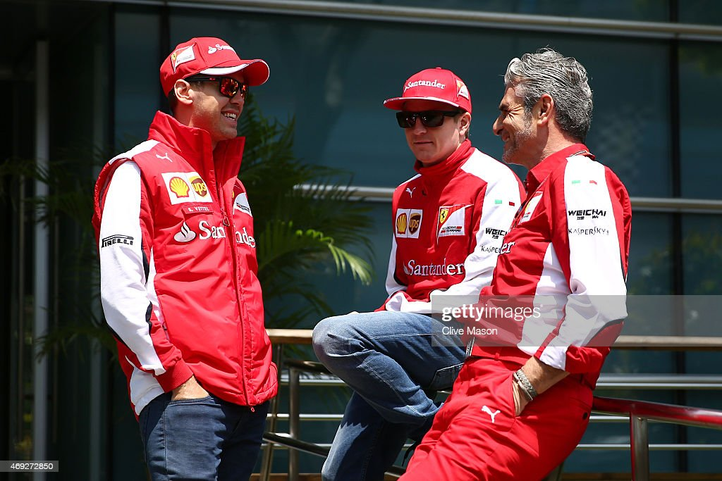 Ferrari Team Principal <a gi-track='captionPersonalityLinkClicked' href=/galleries/search?phrase=Maurizio+Arrivabene&family=editorial&specificpeople=5666002 ng-click='$event.stopPropagation()'>Maurizio Arrivabene</a> chats with <a gi-track='captionPersonalityLinkClicked' href=/galleries/search?phrase=Kimi+Raikkonen&family=editorial&specificpeople=201904 ng-click='$event.stopPropagation()'>Kimi Raikkonen</a> of Finland and Ferrari and <a gi-track='captionPersonalityLinkClicked' href=/galleries/search?phrase=Sebastian+Vettel&family=editorial&specificpeople=2233605 ng-click='$event.stopPropagation()'>Sebastian Vettel</a> of Germany and Ferrari during final practice for the Formula One Grand Prix of China at Shanghai International Circuit on April 11, 2015 in Shanghai, China.