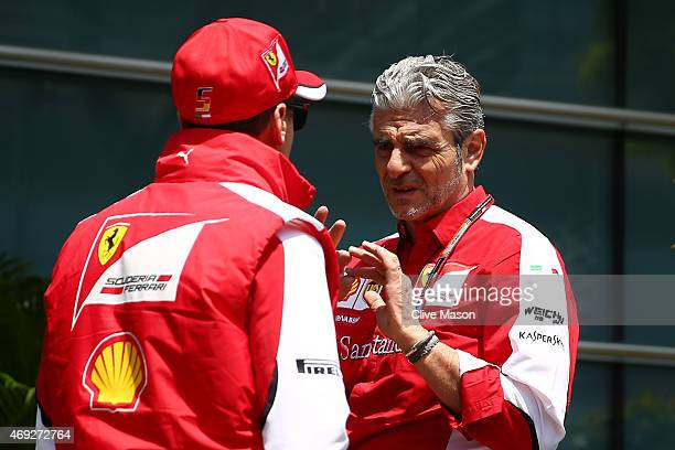 Ferrari Team Principal Maurizio Arrivabene chats with Sebastian Vettel of Germany and Ferrari during final practice for the Formula One Grand Prix of...