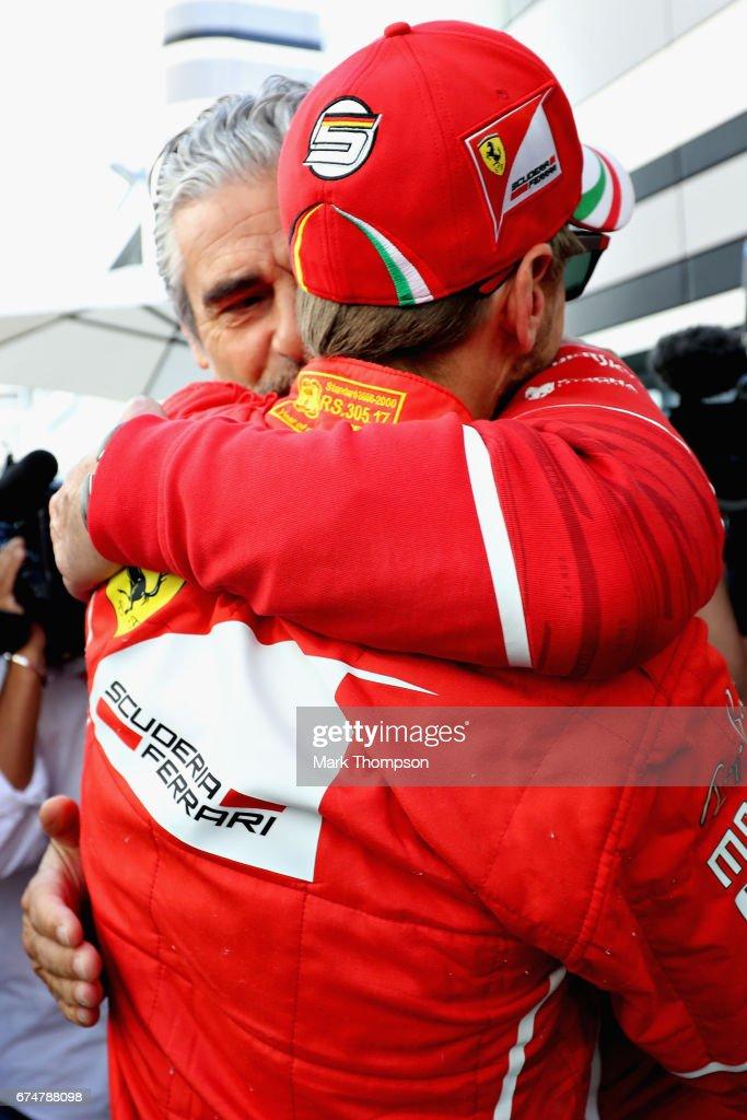 Ferrari Team Principal Maurizio Arrivabene congratulates pole sitter Sebastian Vettel of Germany and Ferrari in the Paddock during qualifying for the Formula One Grand Prix of Russia on April 29, 2017 in Sochi, Russia.