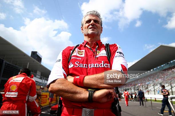 Ferrari Team Principal Maurizio Arrivabene looks on as he stands on the grid before the Formula One Grand Prix of Japan at Suzuka Circuit on...