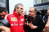 Ferrari Team Principal Maurizio Arrivabene speaks with Fiat CEO Sergio Marchionne in the paddock before the Formula One Grand Prix of Austria at Red...