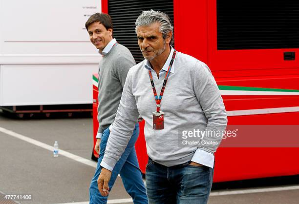 Ferrari Team Principal Maurizio Arrivabene speaks with Mercedes GP Executive Director Toto Wolff in the paddock during practice for the Formula One...