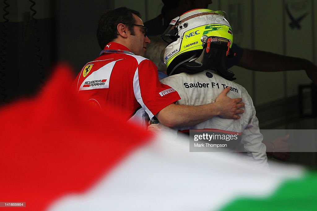 Ferrari Team Principal <a gi-track='captionPersonalityLinkClicked' href=/galleries/search?phrase=Stefano+Domenicali&family=editorial&specificpeople=544864 ng-click='$event.stopPropagation()'>Stefano Domenicali</a> (L) congratulates second placed Sergio Perez (R) of Mexico and Sauber F1 in parc ferme following the Malaysian Formula One Grand Prix at the Sepang Circuit on March 25, 2012 in Kuala Lumpur, Malaysia.