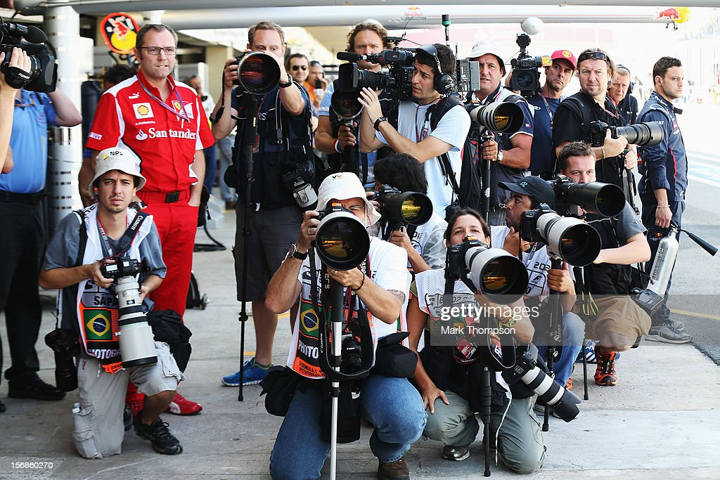 Ferrari Team Principal <a gi-track='captionPersonalityLinkClicked' href=/galleries/search?phrase=Stefano+Domenicali&family=editorial&specificpeople=544864 ng-click='$event.stopPropagation()'>Stefano Domenicali</a> stands amongst photographers as they wait for the arrival of Sebastian Vettel of Germany and Red Bull Racing into the pitlane during practice for the Brazilian Formula One Grand Prix at the Autodromo Jose Carlos Pace on November 23, 2012 in Sao Paulo, Brazil.