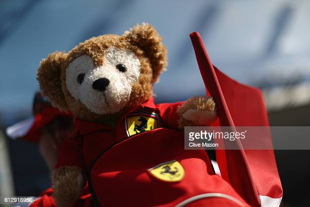 Ferrari teddy bear adorns the head of a fan during previews ahead of the Formula One Grand Prix of Japan at Suzuka Circuit on October 6 2016 in Suzuka