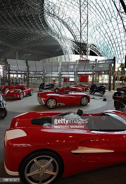 Ferrari vehicles are pictured inside the Ferrari theme park in the Emirati capital of Abu Dhabi on October 26 2010 'Ferrari World Abu Dhabi' will be...