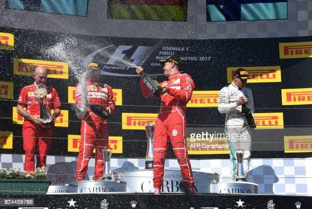 Ferrari's engineer Jock Clear Secondplaced Ferrari's Finnish driver Kimi Raikkonen winner Ferrari's German driver Sebastian Vettel and thirdplaced...