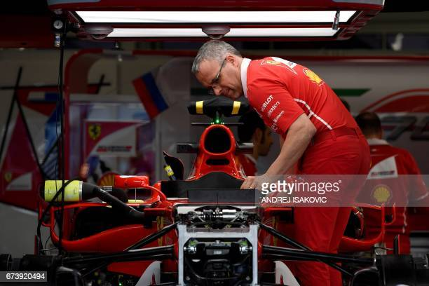 A Ferrari's engineer works on the car of Finnish driver Kimi Raikkonen in the garage at the Sochi Autodrom circuit in Sochi on April 27 2017 The...