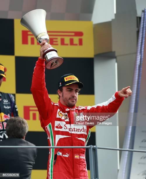 Ferrari's Fernando Alonso celebrates on the podium after the Italian Grand Prix and the Autodromo Nazionale Monza Monza Italy