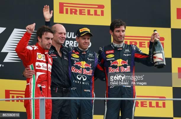Ferrari's Fernando Alonso Red Bull Racing's chief technical officer Adrian Newey Red Bull Racing's Sebastian Vettel and Mark Webber celebrate on the...