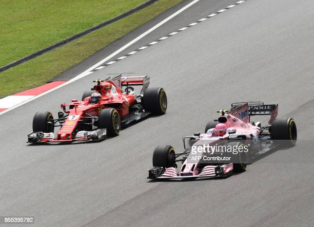 Ferrari's Finland driver Kimi Raikkonen and Force India's French driver Esteban Ocon compete during their second practice session of the Formula One...