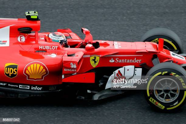 Ferrari's Finland driver Kimi Raikkonen drives during the qualifying session of the Formula One Japanese Grand Prix at Suzuka on October 7 2017 / AFP...