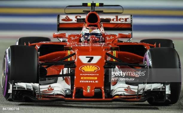 Ferrari's Finland driver Kimi Raikkonen takes a corner during the second practice session of the Formula One Singapore Grand Prix in Singapore on...