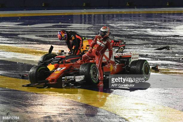 Ferrari's Finnish driver Kimi Raikkonen and Red Bull's Dutch driver Max Verstappen get out from their cars after a crash during the Formula One...
