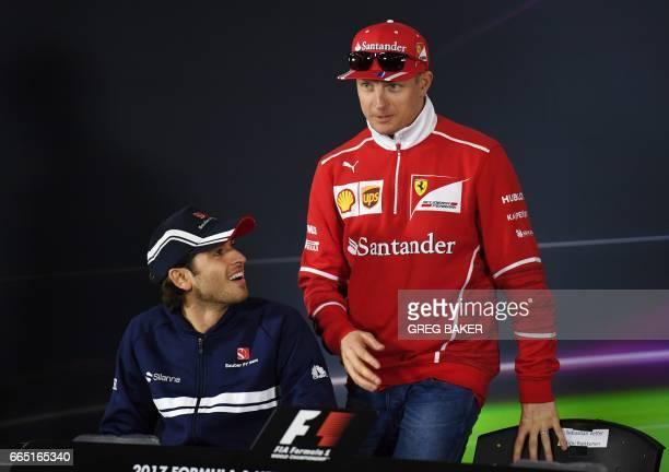 Ferrari's Finnish driver Kimi Raikkonen arrives for a press conference with Sauber's Italian driver Antonio Giovinazzi in Shanghai on April 6 ahead...