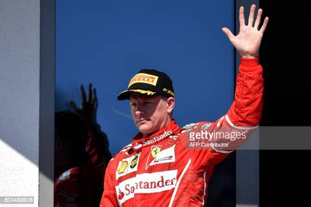 Ferrari's Finnish driver Kimi Raikkonen celebrates after he took the second place during the Formula One Hungarian Grand Prix at the Hungaroring...