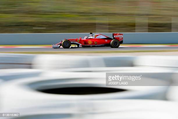 TOPSHOT Ferrari's Finnish driver Kimi Raikkonen drives at the Circuit de Catalunya on March 3 2016 in Montmelo on the outskirts of Barcelona during...
