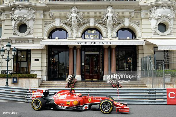 Ferrari's Finnish driver Kimi Raikkonen drives at the Monaco street circuit during the first practice session of the Monaco Formula One Grand Prix in...