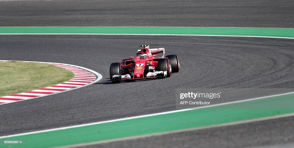 Ferrari's Finnish driver Kimi Raikkonen drives during the Formula One Japanese Grand Prix at Suzuka on October 8, 2017. / AFP PHOTO / Behrouz MEHRI