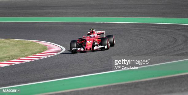 Ferrari's Finnish driver Kimi Raikkonen drives during the Formula One Japanese Grand Prix at Suzuka on October 8 2017 / AFP PHOTO / Behrouz MEHRI