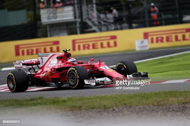Ferrari's Finnish driver Kimi Raikkonen drives during the qualifying session of the Formula One Japanese Grand Prix at Suzuka on October 7 2017 / AFP...