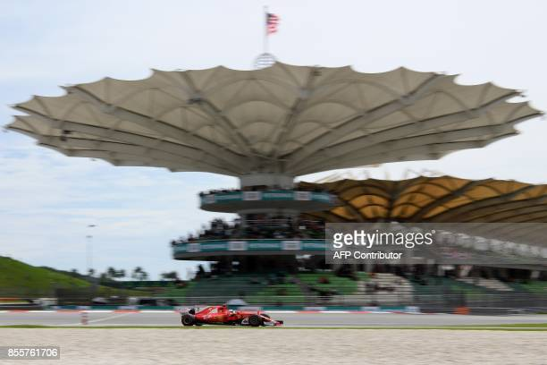 Ferrari's Finnish driver Kimi Raikkonen drives his car during the third practice session of the Formula One Malaysia Grand Prix in Sepang on...