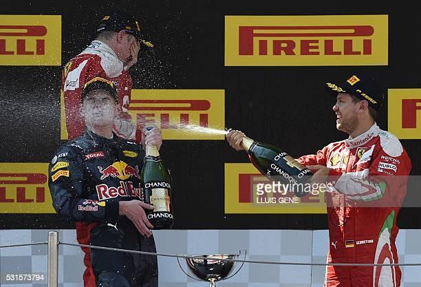 Ferrari's Finnish driver Kimi Raikkonen Infiniti Red Bull's BelgianDutch driver Max Verstappen and Ferrari's German driver Sebastian Vettel celebrate...