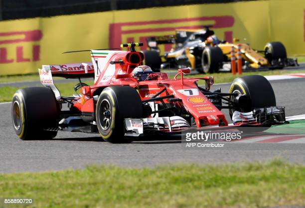 Ferrari's Finnish driver Kimi Raikkonen leads Renault's German driver Nico Hulkenberg during the Formula One Japanese Grand Prix at Suzuka on October...