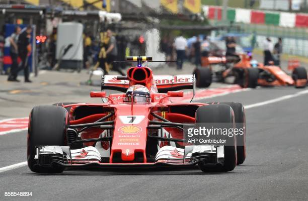 Ferrari's Finnish driver Kimi Raikkonen leaves the pit during the qualifying session of the Formula One Japanese Grand Prix at Suzuka on October 7...
