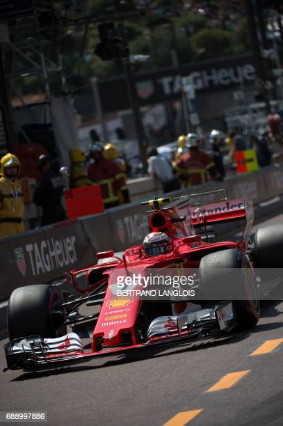 Ferrari's Finnish driver Kimi Raikkonen leaves the pit during the third practice session at the Monaco street circuit on May 27 2017 in Monaco on the...