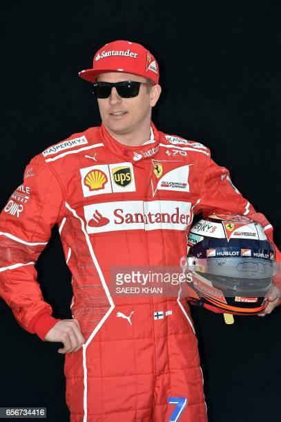 Ferrari's Finnish driver Kimi Raikkonen poses for a photo in Melbourne on March 23 ahead of the Formula One Australian Grand Prix / AFP PHOTO / Saeed...