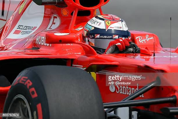 Ferrari's Finnish driver Kimi Raikkonen powers his car during the third practice session of the Formula One Malaysia Grand Prix in Sepang on...
