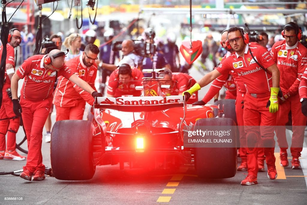 TOPSHOT - Ferrari's Finnish driver Kimi Raikkonen prepares to leave the pits for the second practice session at the Spa-Francorchamps circuit in Spa on August 25, 2017 ahead of the Belgian Formula One Grand Prix. / AFP PHOTO / Emmanuel DUNAND