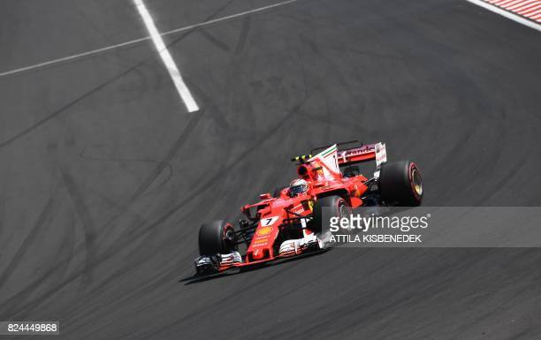 TOPSHOT Ferrari's Finnish driver Kimi Raikkonen races at the Hungaroring circuit in Budapest on July 30 during the Formula One Hungarian Grand Prix /...
