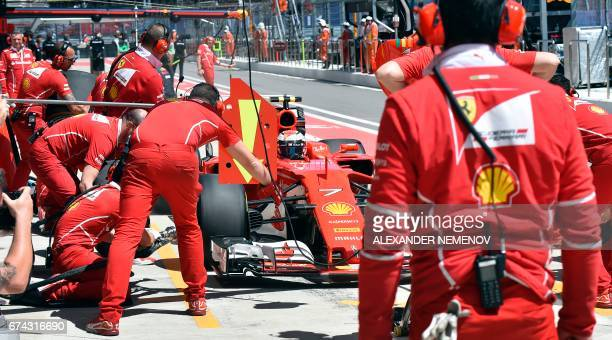 Ferrari's Finnish driver Kimi Raikkonen sits in his car during the first practice session of the Formula One Russian Grand Prix at the Sochi Autodrom...