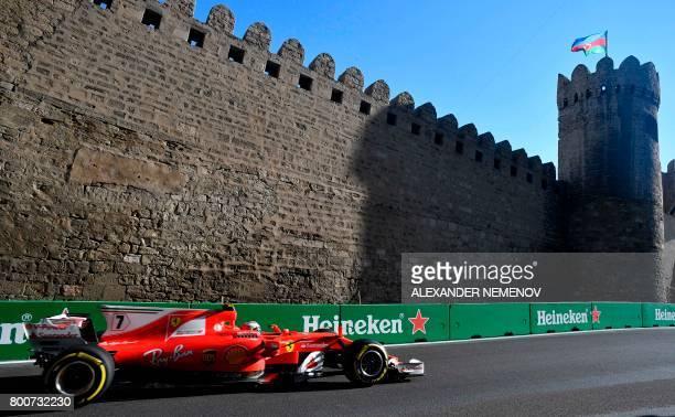 TOPSHOT Ferrari's Finnish driver Kimi Raikkonen steers his car during the Formula One Azerbaijan Grand Prix at the Baku City Circuit in Baku on June...