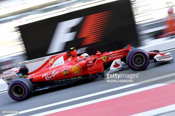 Ferrari's Finnish driver Kimi Raikkonen steers his car during the second practice session of the Formula One Russian Grand Prix at the Sochi Autodrom...