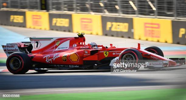 Ferrari's Finnish driver Kimi Raikkonen steers his car during the qualifying session for the Formula One Azerbaijan Grand Prix at the Baku City...