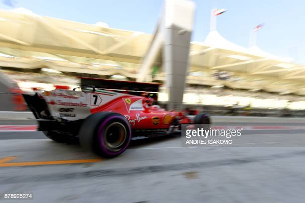 Ferrari's Finnish driver Kimi Raikkonen steers his car during the third practice session ahead of the Abu Dhabi Formula One Grand Prix at the Yas...
