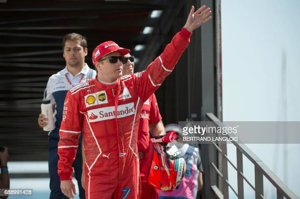 Ferrari's Finnish driver Kimi Raikkonen waves as he arrives to attend the third practice session on May 27 2017 at the Monaco street circuit on the...