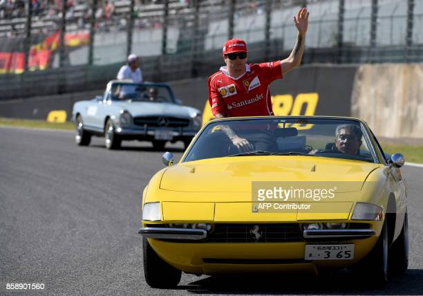 Ferrari's Finnish driver Kimi Raikkonen waves during the drivers' parade of the Formula One Japanese Grand Prix at Suzuka on October 8 2017 / AFP...