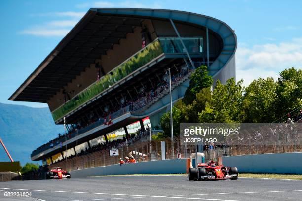 Ferrari's German driver Sebastian Vettel and Ferrari's Finish driver Kimi Raikkonen drive during the first practice session at the Circuit de...