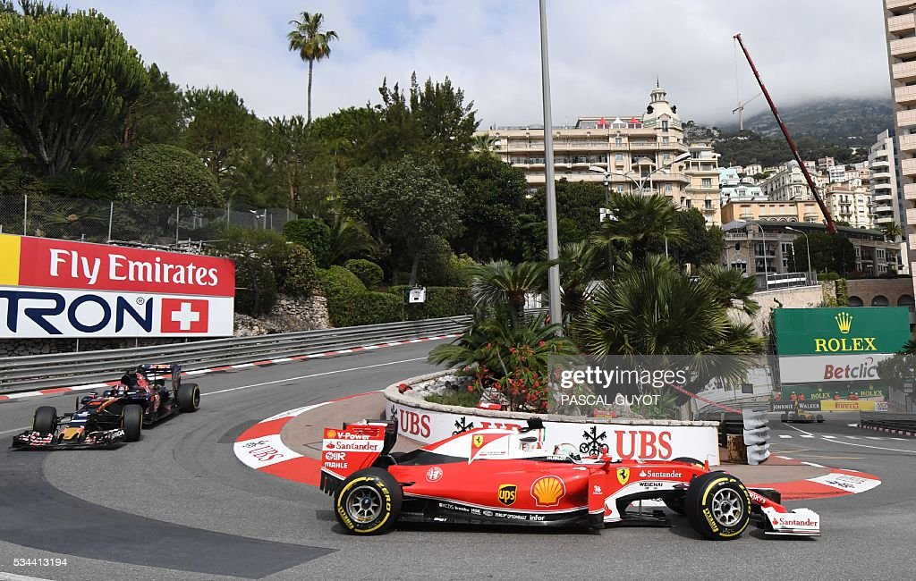 Ferrari's German driver Sebastian Vettel (R) and Scuderia Toro Rosso's Russian driver Daniil Kvyat (L) drive during the first practice session at the Monaco street circuit, on May 26, 2016 in Monaco, three days ahead of the Monaco Formula 1 Grand Prix. / AFP / PASCAL