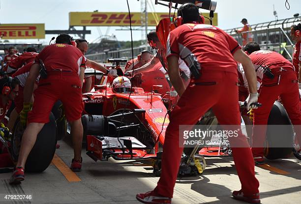 Ferrari's German driver Sebastian Vettel arrives in the pits during the second practice session at the Silverstone circuit in Silverstone on July 2...