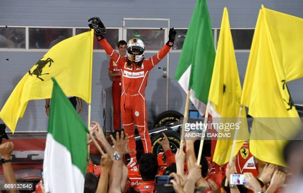 Ferrari's German driver Sebastian Vettel celebrates after winning the Bahrain Formula One Grand Prix at the Sakhir circuit in Manama on April 16 2017...